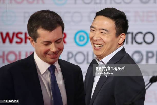 Democratic presidential candidate South Bend, Indiana Mayor Pete Buttigieg and former tech executive Andrew Yang share a laugh during the Democratic...