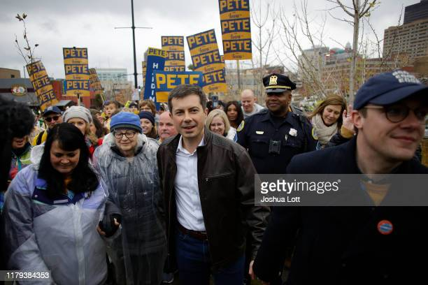 Democratic presidential candidate, South Bend, Indiana Mayor Pete Buttigieg walks with his husband Chasten Buttigieg before the Iowa Democratic Party...