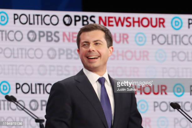 Democratic presidential candidate South Bend Indiana Mayor Pete Buttigieg reacts during the Democratic presidential primary debate at Loyola...