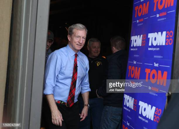 Democratic presidential candidate Tom Steyer exits after a campaign stop at the The Living Room on January 31 2020 in Clinton Iowa Iowa's...