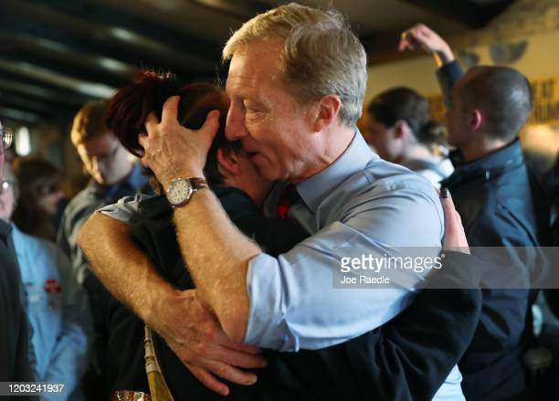Democratic presidential candidate Tom Steyer hugs a person as she became emotional while speaking to him during his campaign stop at the The Living...