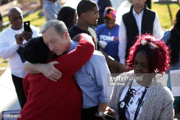 Democratic presidential candidate Tom Steyer hugs a supporter during a campaign event at Martin Luther King Jr Senior Center February 14 2020 in Las...