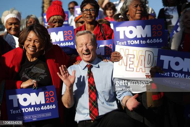 Democratic presidential candidate Tom Steyer reacts as he poses with supporters during a campaign event at Martin Luther King Jr Senior Center...