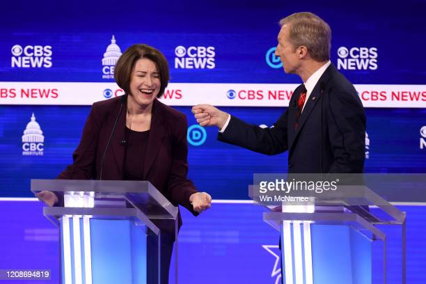 Democratic presidential candidate Tom Steyer speaks as Sen Amy Klobuchar reacts during the Democratic presidential primary debate at the Charleston...