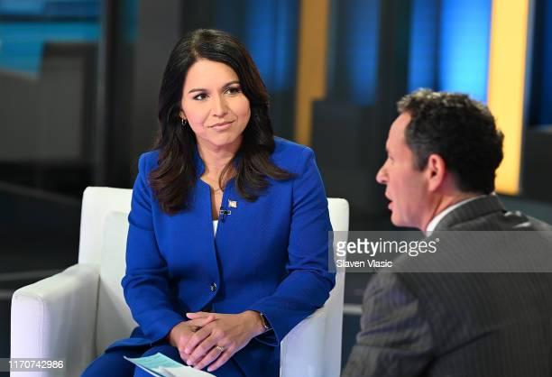 "Democratic Presidential Candidate Tulsi Gabbard talks to host Brian Kilmeade at ""FOX & Friends"" at Fox News Channel Studios on September 24, 2019 in..."