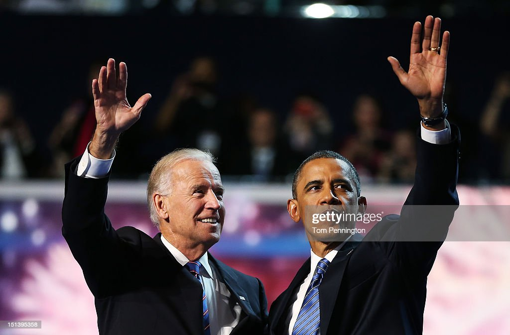 Democratic presidential candidate, U.S. President Barack Obama (R) and Democratic vice presidential candidate, U.S. Vice President Joe Biden wave after accepting the nomination during the final day of the Democratic National Convention at Time Warner Cable Arena on September 6, 2012 in Charlotte, North Carolina. The DNC, which concludes today, nominated U.S. President Barack Obama as the Democratic presidential candidate.