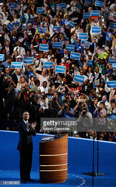 Democratic presidential candidate US President Barack Obama claps on stage as he accepts the nomination for president during the final day of the...