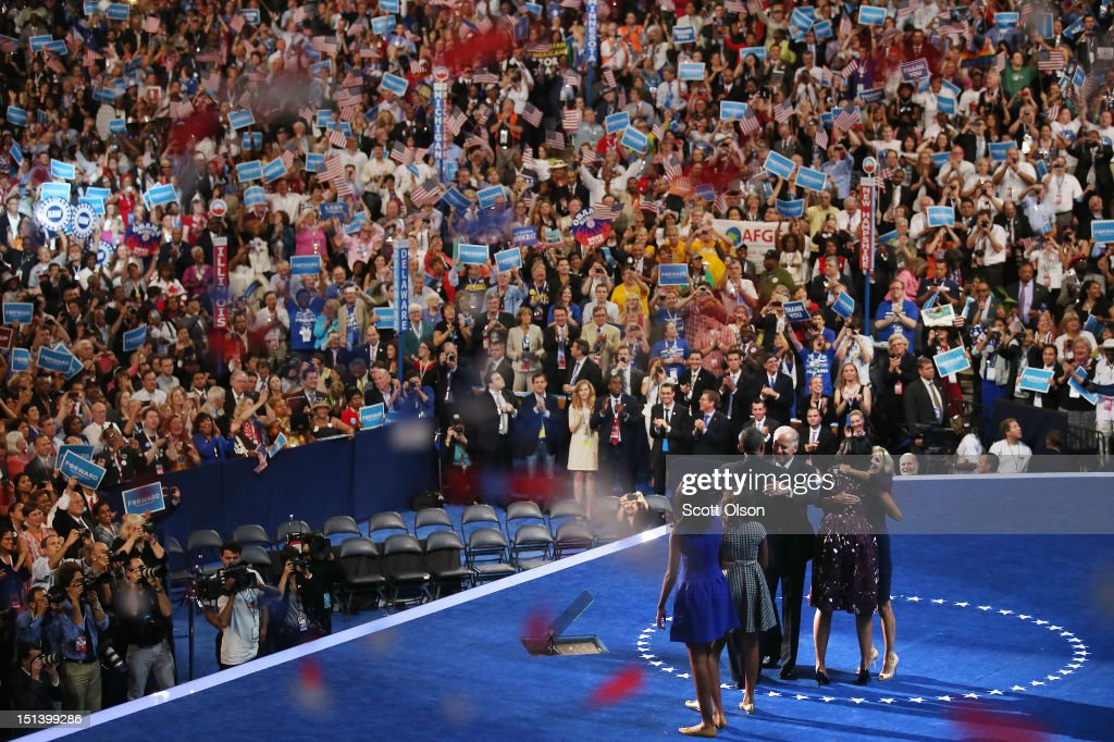 Democratic presidential candidate, U.S. President Barack Obama (C) hugs Democratic vice presidential candidate, U.S. Vice President Joe Biden as Second lady Dr. Jill Biden (L) hugs First lady Michelle Obama, as Sasha Obama and Malia Obama (R) stand on stage after accepting the nomination during the final day of the Democratic National Convention at Time Warner Cable Arena on September 6, 2012 in Charlotte, North Carolina. The DNC, which concludes today, nominated U.S. President Barack Obama as the Democratic presidential candidate.