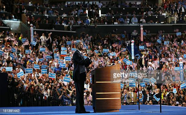 Democratic presidential candidate US President Barack Obama stands on stage to accept the nomination for president during the final day of the...