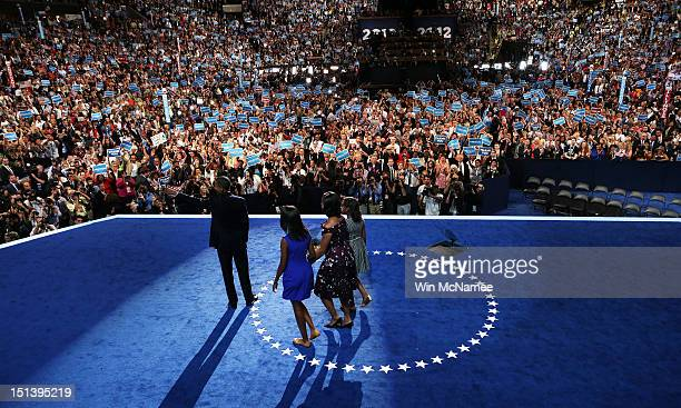 Democratic presidential candidate US President Barack Obama stands on stage after accepting the nomination with his family Sasha Obama First lady...