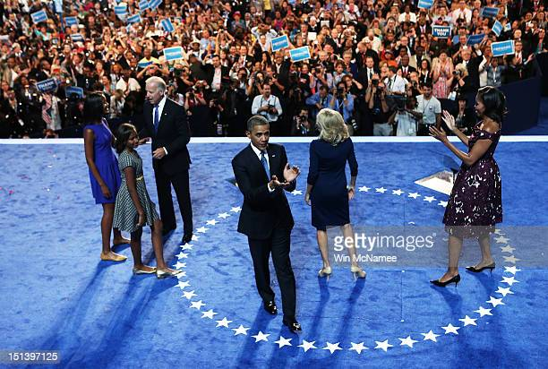 Democratic presidential candidate US President Barack Obama stands on stage after accepting the nomination with his family Malia Obama Sasha Obama...