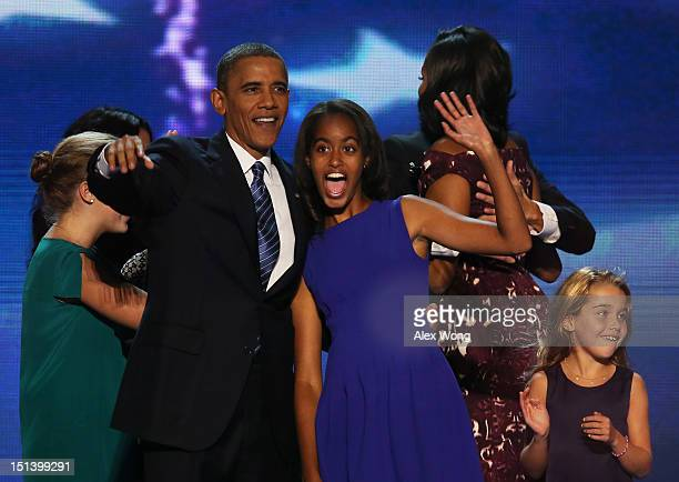 Democratic presidential candidate US President Barack Obama stands on stage with Malia Obama after accepting the nomination during the final day of...