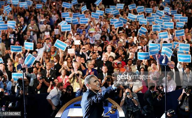 Democratic presidential candidate US President Barack Obama waves on stage as he accepts the nomination for president during the final day of the...