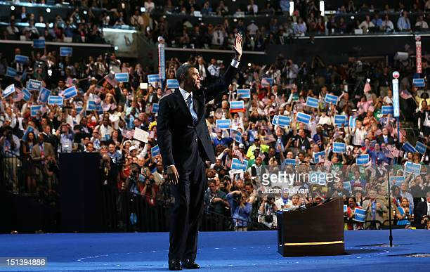 Democratic presidential candidate US President Barack Obama waves on stage after accepting the nomination during the final day of the Democratic...