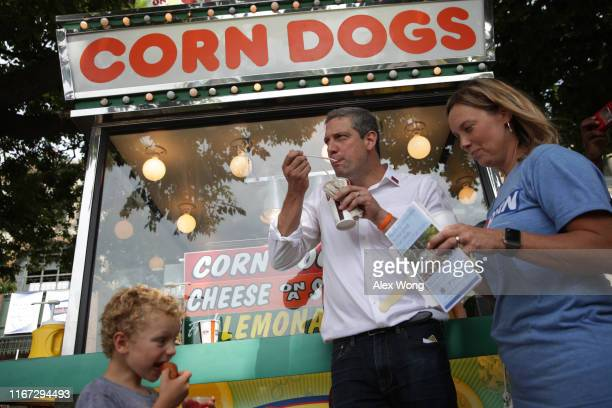 Democratic presidential candidate U.S. Rep. Tim Ryan , his wife Andrea Zetts and his son Brady Ryan eat fair food after he delivered a campaign...