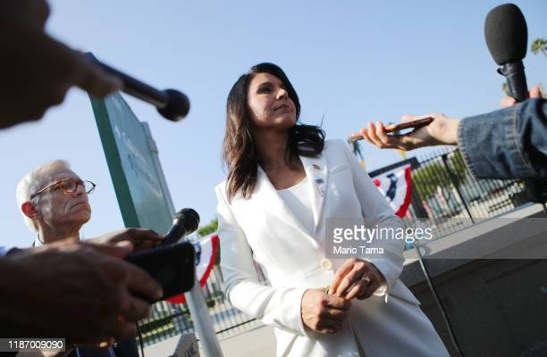 Democratic presidential candidate US Rep Tulsi Gabbard meets with reporters at the inaugural Veterans Day LA event held outside of the Los Angeles...