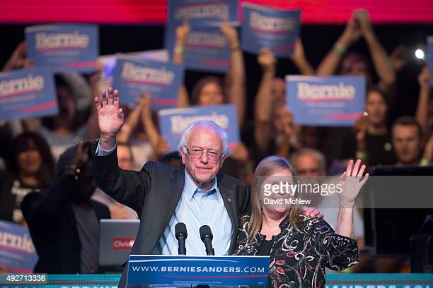 Democratic presidential candidate US Sen Bernie Sanders and his wife Dr Jane O'Meara Sanders wave to supporters at a campaign fundraising reception...