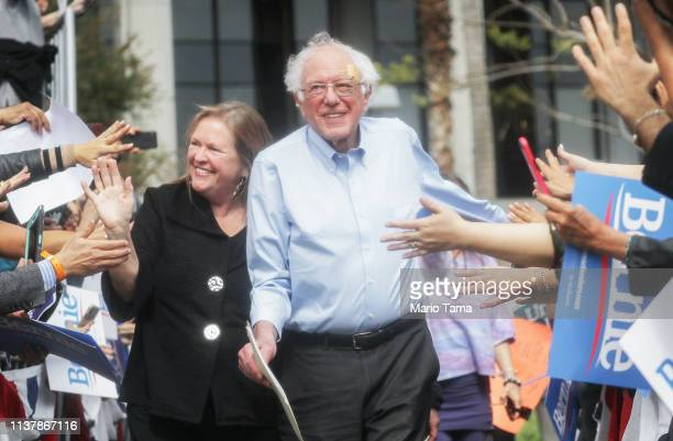 Democratic presidential candidate US Sen Bernie Sanders C arrives with his wife Jane at a campaign rally in Grand Park on March 23 2019 in Los...