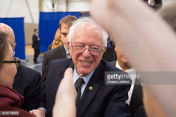 Democratic presidential candidate US Sen Bernie Sanders greets guests in the Activities and Recreation Center on the campus of the University of...
