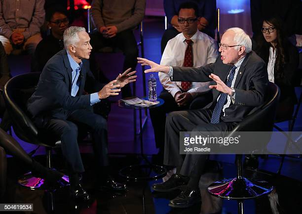 Democratic presidential candidate US Sen Bernie Sanders speaks with moderator Jorge Ramos during the the Iowa Brown and Black Forum sponsored by...