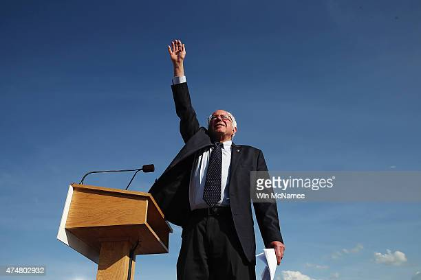 Democratic presidential candidate US Sen Bernie Sanders waves to supporters before he speaks during the kick off of his presidential campaign on May...