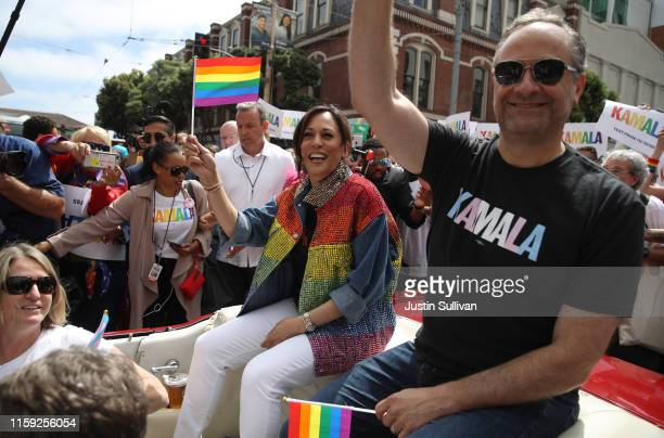Democratic presidential candidate U.S. Sen. Kamala Harris and her husband Douglas Emhoff wave to the crowd as they ride in a car during the SF Pride...