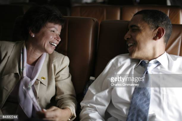 Democratic presidential candidate US Senator Barack Obama and senior advisor Valerie Jarrett chat on their campaign plane June 21 2008 enroute to...