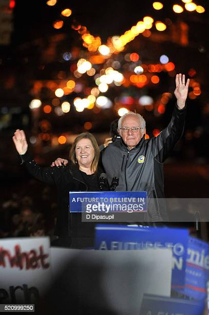 Democratic presidential candidate US Senator Bernie Sanders and wife Jane Sanders wave to supporters at a campaign event at Washington Square Park on...