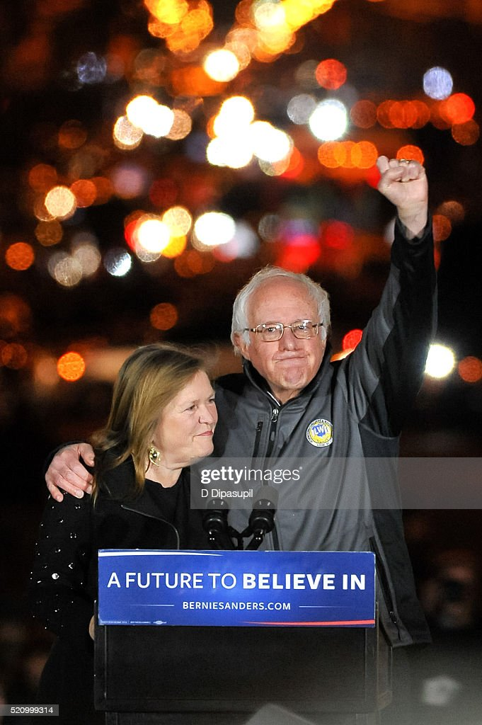 Democratic presidential candidate U.S. Senator Bernie Sanders (I-VT) (R) and wife Jane Sanders greet supporters at a campaign event at Washington Square Park on April 13, 2016 in New York City.