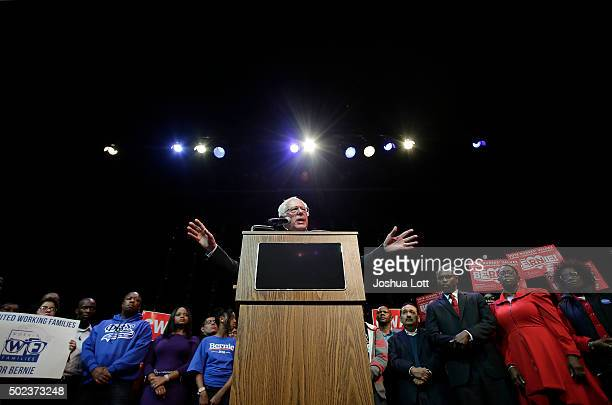 Democratic presidential candidate US Senator Bernie Sanders is joined by local activist and community members as he speaks during a news conference...