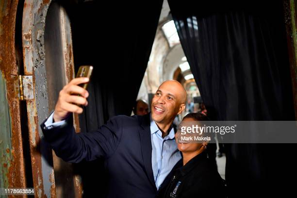 Democratic Presidential candidate, U.S. Senator Cory Booker takes a selfie with a supporter during a town hall at the Eastern State Penitentiary on...
