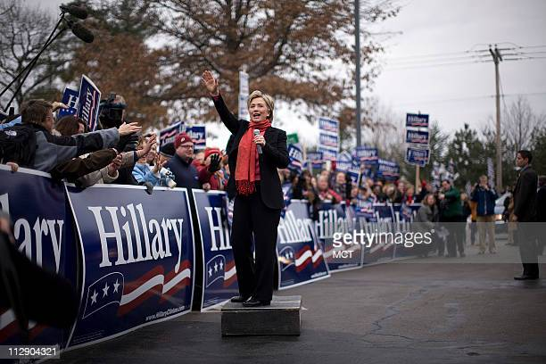 Democratic presidential candidate US Senator Hillary Clinton talks to supporters preparing to canvass for her in Manchester New Hampshire Sunday...