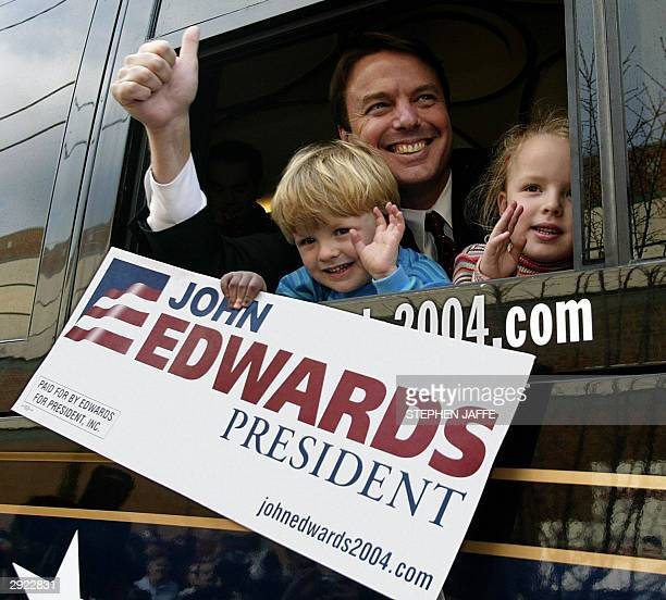 Democratic presidential candidate US Senator John Edwards greets supporters from his bus with his son Jack and daughter EmmaKate after speaking at...