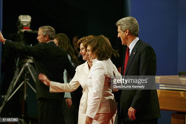 Democratic presidential candidate US Senator John Kerry and wife Theresa Heinz Kerry along with first lady Laura Bush face the crowd after the first...