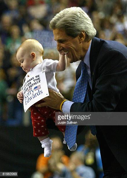 Democratic presidential candidate U.S. Senator John Kerry holds a baby during a rally at the University of Nevada October 22, 2004 in Reno, Nevada....