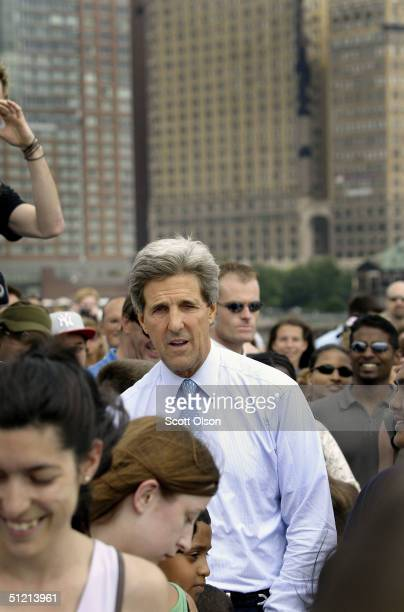 Democratic presidential candidate US Senator John Kerry works his way through a crowd on New York Harbor prior to boarding a boat for Liberty Island...