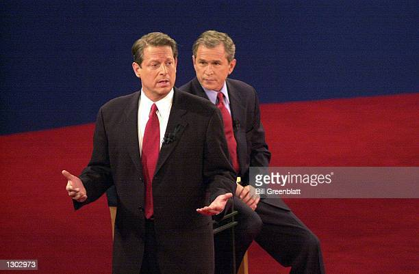 Democratic presidential candidate Vice President Al Gore talks to the audience while the Republican candidate Texas governor George W Bush looks on...