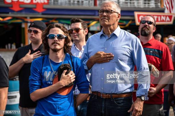 Democratic presidential candidate Washington Gov Jay Inslee stands for the National Anthem at the Iowa State Fair on August 10 2019 in Des Moines...