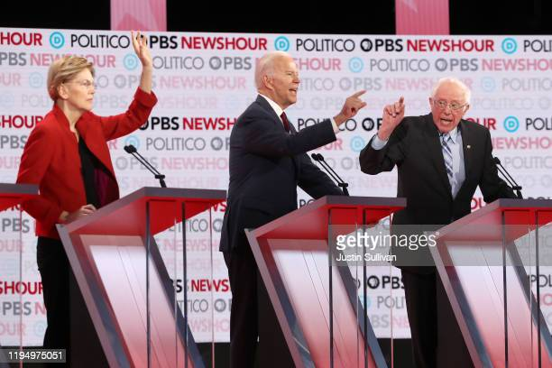 Democratic presidential candidates Elizabeth Warren former Vice President Joe Biden and Sen Bernie Sanders gesture during the Democratic presidential...