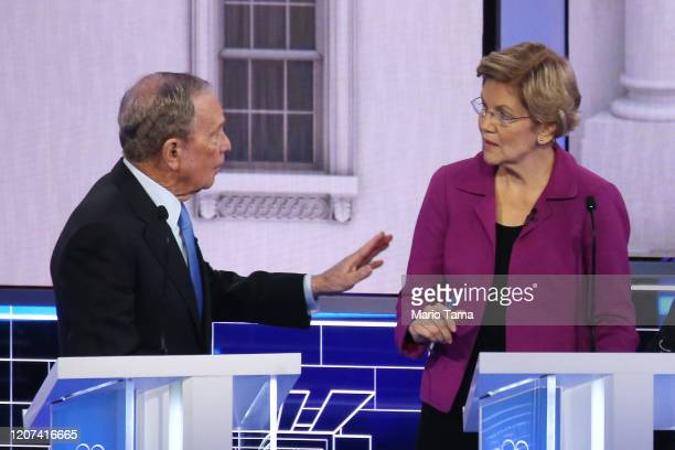 Democratic presidential candidates former New York City Mayor Mike Bloomberg and Sen Elizabeth Warren speak during the Democratic presidential...