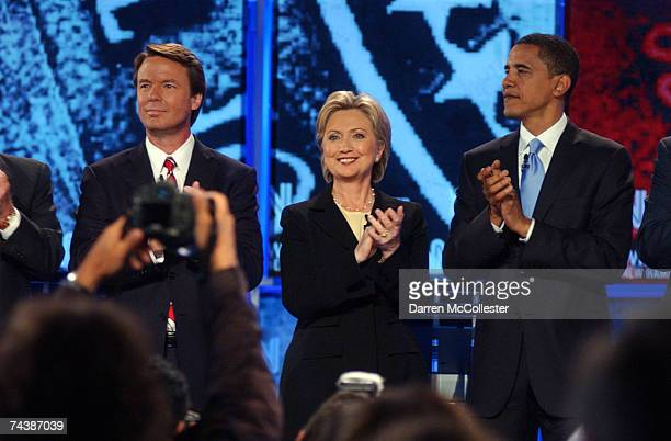 Democratic presidential candidates former Sen John Edwards Sen Hillary Clinton and Sen Barack Obama applaud as they take to the stage as they prepare...