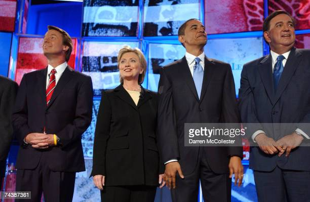 Democratic presidential candidates former Sen John Edwards Sen Hillary Clinton Sen Barack Obama and New Mexico Gov Bill Richardson take the stage as...