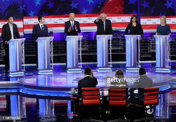 Democratic presidential candidates former tech executive Andrew Yang South Bend Indiana Mayor Pete Buttigieg former Vice President Joe Biden Sen...