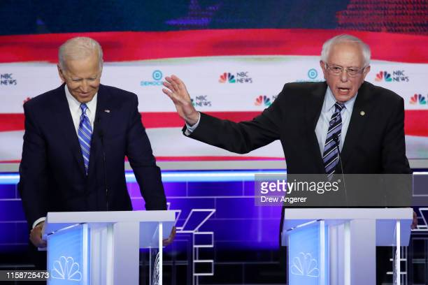Democratic presidential candidates former Vice President Joe Biden and Sen Bernie Sanders speak during the second night of the first Democratic...