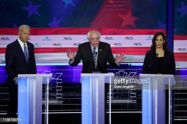 Democratic presidential candidates former Vice President Joe Biden Sen Bernie Sanders and Sen Kamala Harris take part in the second night of the...