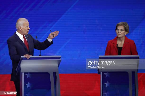 Democratic presidential candidates former Vice President Joe Biden and Sen. Elizabeth Warren interact on stage during the Democratic Presidential...