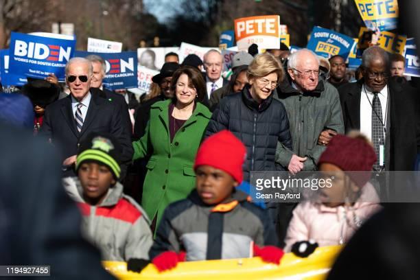 Democratic presidential candidates, former Vice President Joe Biden, left, Sen. Amy Klobuchar , Sen. Elizabeth Warren , and Sen. Bernie Sanders ,...