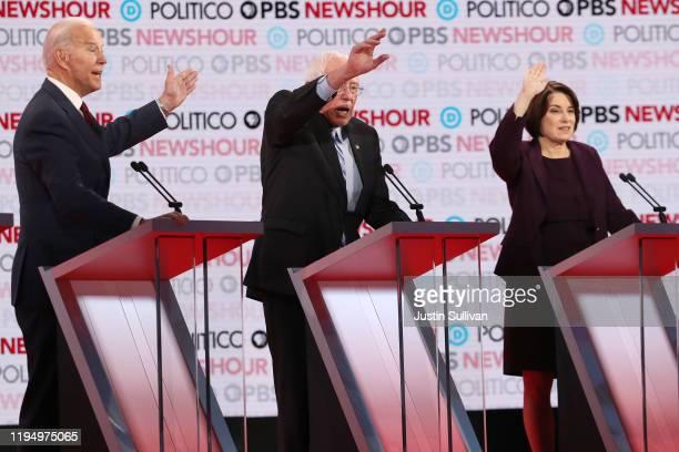 Democratic presidential candidates former Vice President Joe Biden Sen Bernie Sanders and Sen Amy Klobuchar gesture during the Democratic...
