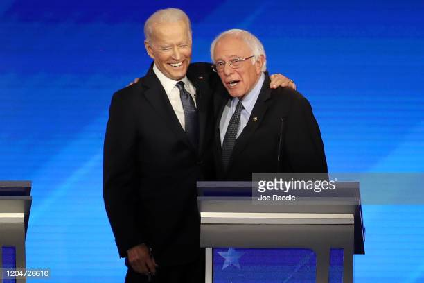 Democratic presidential candidates former Vice President Joe Biden and Sen Bernie Sanders share a moment during the Democratic presidential primary...