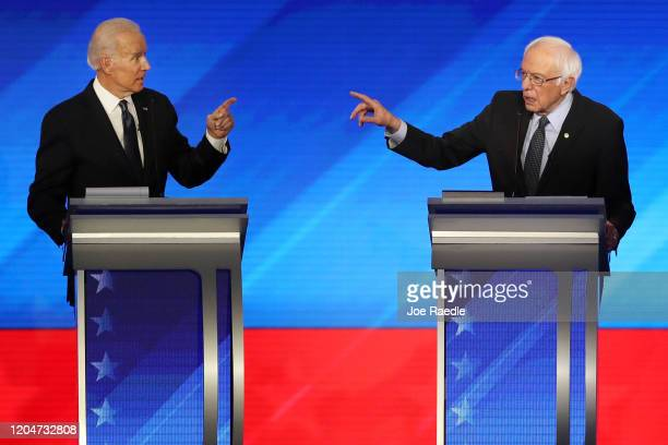 Democratic presidential candidates former Vice President Joe Biden and Sen Bernie Sanders participate in the Democratic presidential primary debate...